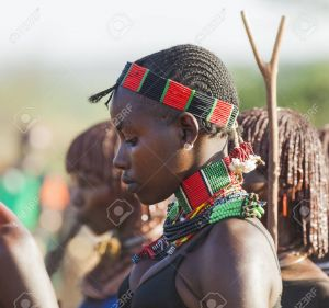 TURMI, OMO VALLEY, ETHIOPIA - DECEMBER 30, 2013: Portrait of unidentified young Hamar woman at bull jumping ceremony. Jumping of the bull is a rite of passage into manhood in some Omo Valley tribes.